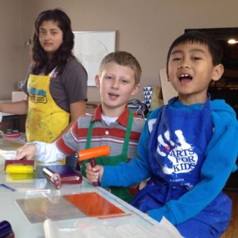 three kids posing for camera while printmaking with Wingtip Press